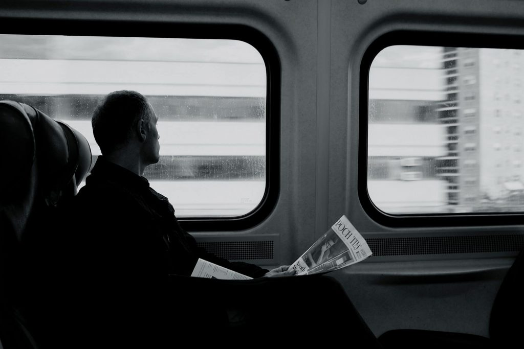 Man on a Train, looking out the window