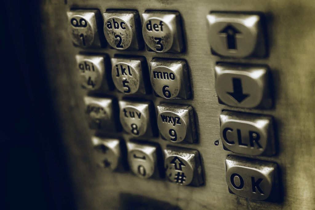 Picture of an old payphone dial pad