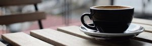 Coffee cup on a picnic table
